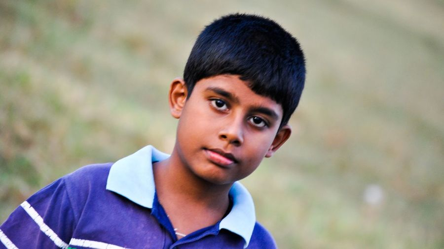 Close-up portrait teenage boy standing outdoors