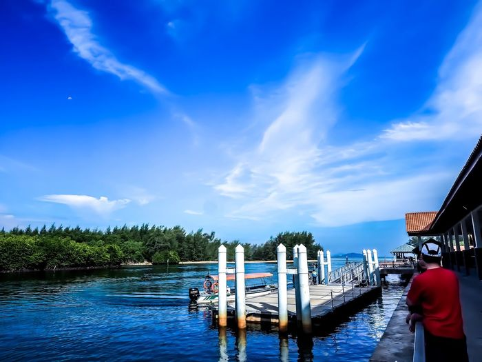 Clear sky at Merang Jetty EyeEmNewHere M.zuiko 12-40mm F2.8 Pro Jetty Water Sky Cloud - Sky Nature Real People Day Nautical Vessel Mode Of Transportation Transportation Blue One Person Beauty In Nature Outdoors Scenics - Nature Men