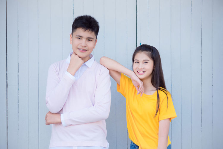 Asian teenager boy and girl standing and smile in front of wood background Girl Boy Background Teen Teenager Couple Teeth Brace Standing Teenage Happy Young Woman Shirt Teenagers  Attractive People Teens Two Female Old Smile Together Friends Casual Male Man Happiness Looking Portrait Brother Beautiful Guy Model Sister Tshirt person Smiling Friend Student Youth Friendship Asian  Thai Two People Positive Emotion Front View Looking At Camera Emotion Casual Clothing Togetherness