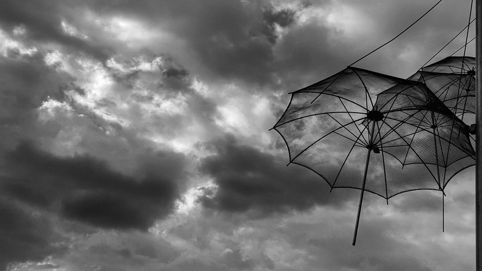Monochrome Photography Look Up And Thrive Umbrellas Outdoors Majestic Cloud - Sky Cloudy Sky Monochromatic Beauty In Nature Blackandwhite Sky And Clouds Umbrella Low Angle View Lookingup Morning Sky Blackandwhite Photography Seeing The Sights Citysights Architecture Architectural Feature Art Check This Out Eye4photography  EyeEm Gallery Uniqueness