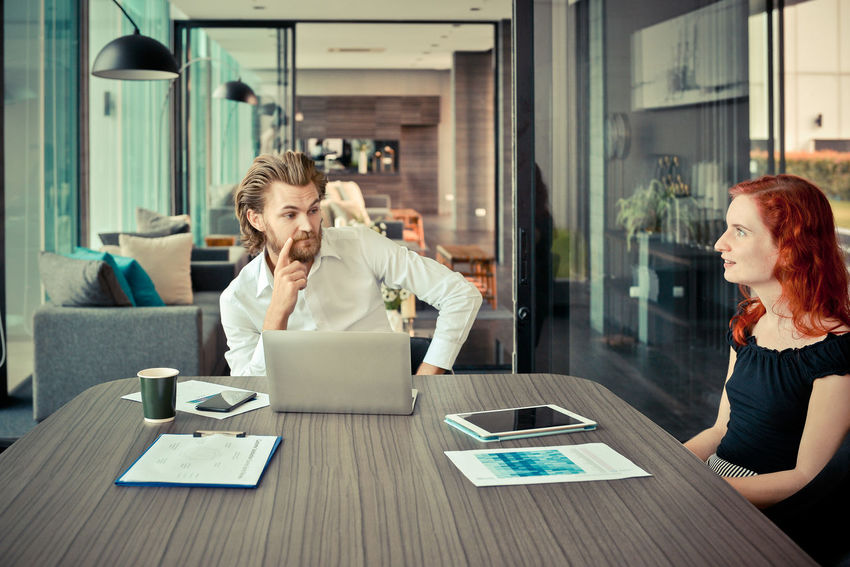 Western businessman blaming his employee in office, problem Brainstorming Discussing Adult Business Business People Business Person Businessman Businesswoman Colleagues Communication Computer Digital Tablet Group Indoors  Laptop Meeting Room Men Multi Ethnic Occupation Office Sitting Table Teamwork Technology Two People Using Laptop Western Wireless Technology Women Working Young Adult Young Men Young Women