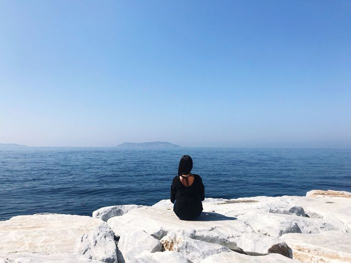 Istanbul Blues Istanbul Sea Sitting Water Leisure Activity Sky Beauty In Nature One Person Outdoors Nature Horizon Horizon Over Water Real People Scenics - Nature Lifestyles Clear Sky This Is Queer EyeEmNewHere