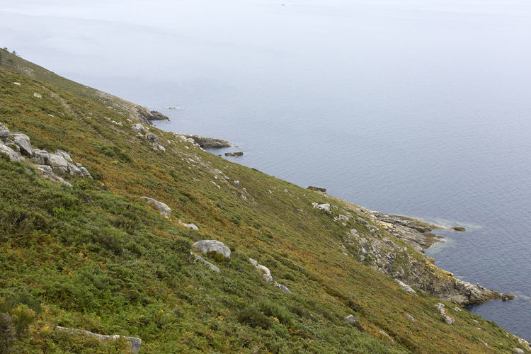 High angle view of land and sea against sky