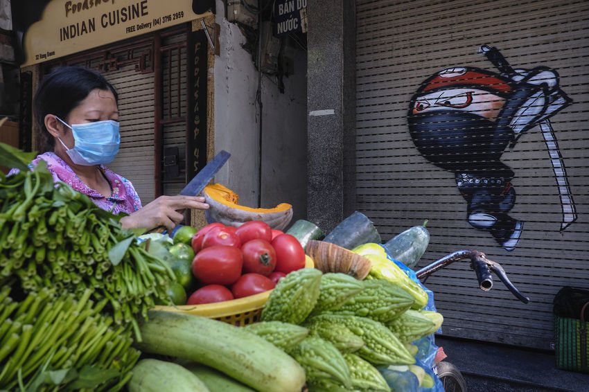 The woman sells vegetables and fruits on the street. This is a common image that appears in Hanoi, Vietnam. #fruitninja #fujifilm #funny #hanoi #ninja #street #streetphotography #Vietnam #vietnamese #Vietnamese Food #VietnamLife Day Food Food And Drink Freshness Fruit Healthy Eating Market Stall Outdoors People Retail  Vegetable