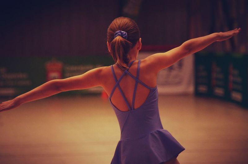 Rear view of girl dancing