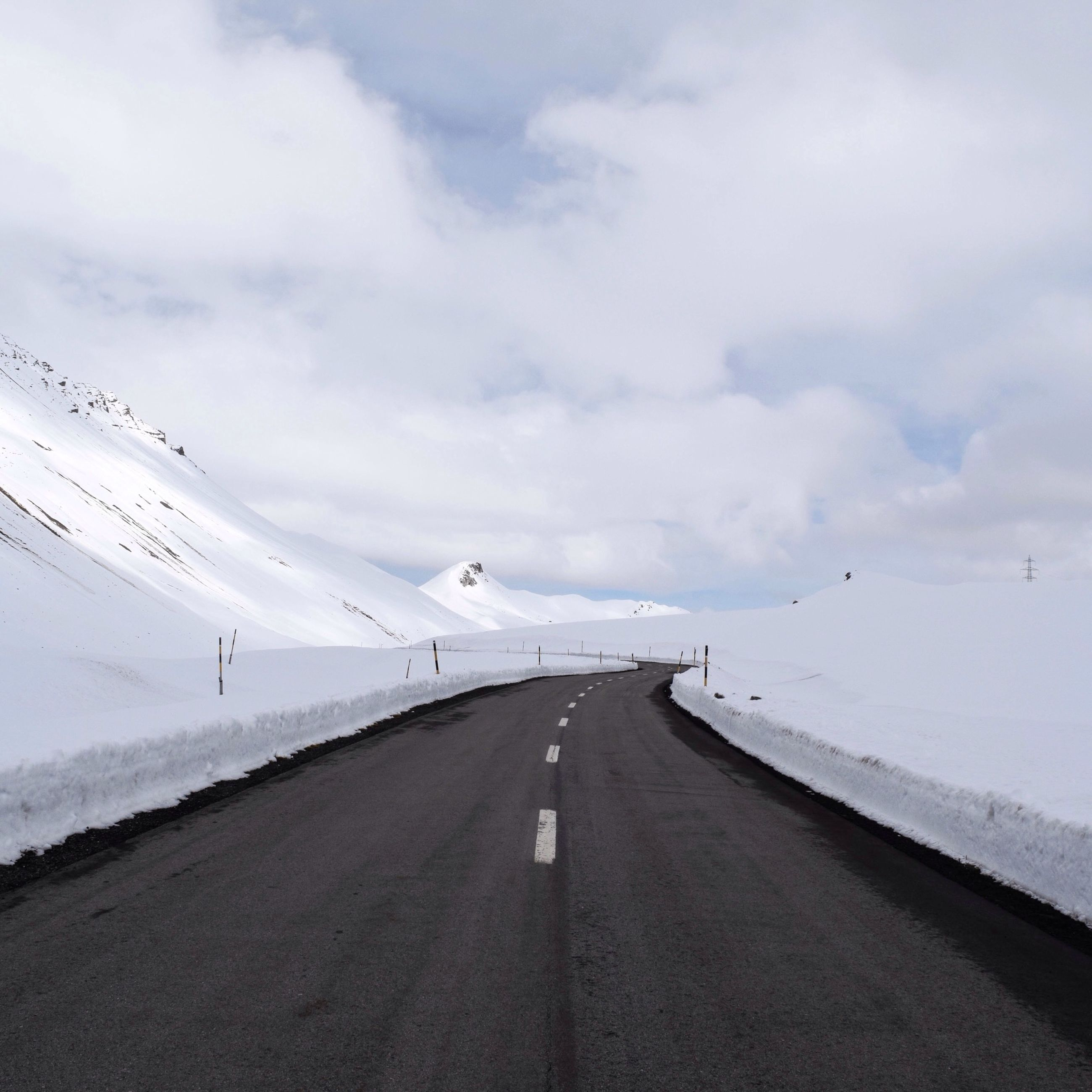 the way forward, flying, transportation, sky, road, diminishing perspective, vanishing point, cloud - sky, road marking, landscape, animal themes, snow, wildlife, mountain, cloudy, nature, bird, mid-air, tranquil scene, weather