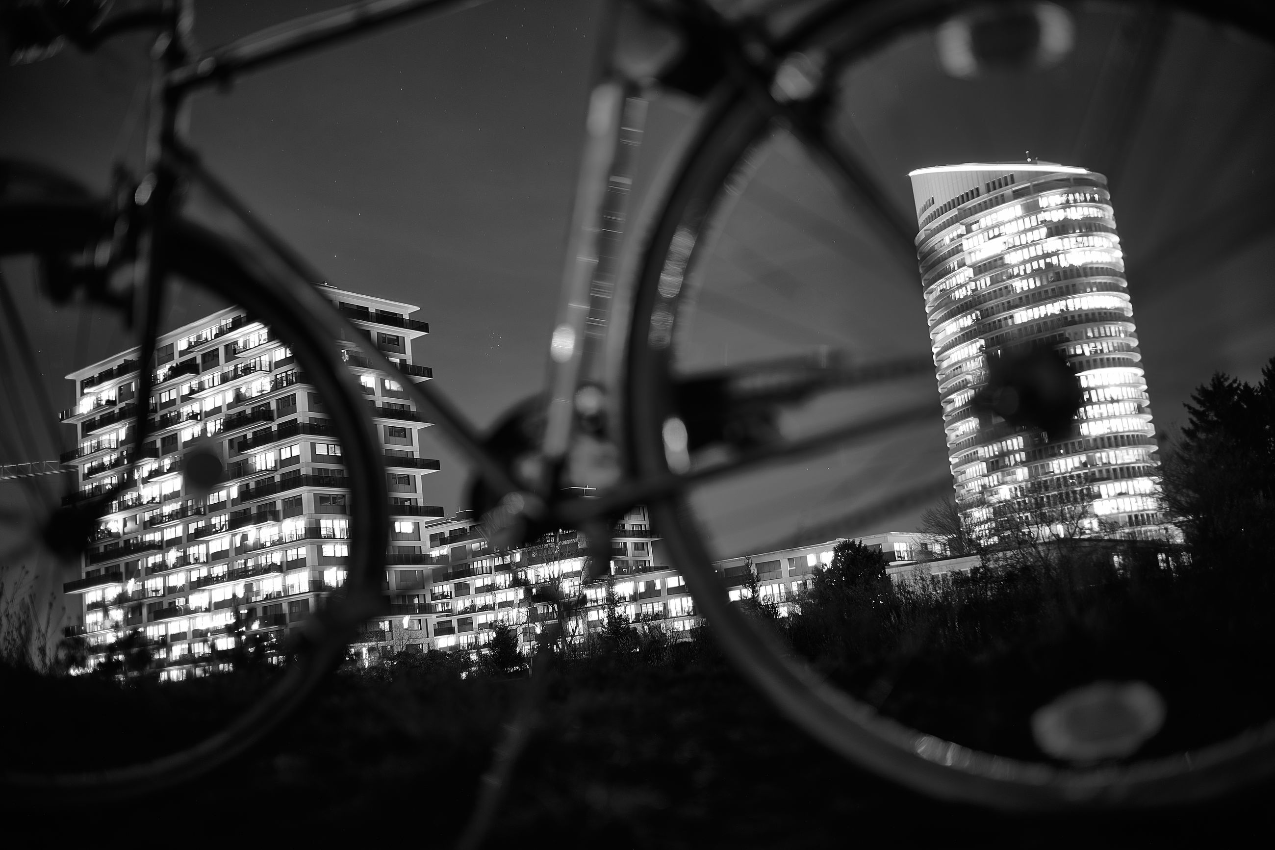 black, black and white, light, architecture, built structure, darkness, white, no people, monochrome, monochrome photography, transportation, selective focus, city, close-up, building exterior, outdoors, wheel, nature, night
