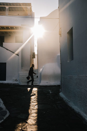Full length side view of woman walking in building