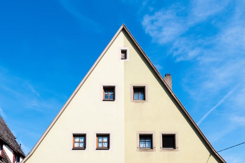 Low angle view of building against sky. Blue Triangle Shape House Place Of Worship Sky Architecture Building Exterior Built Structure