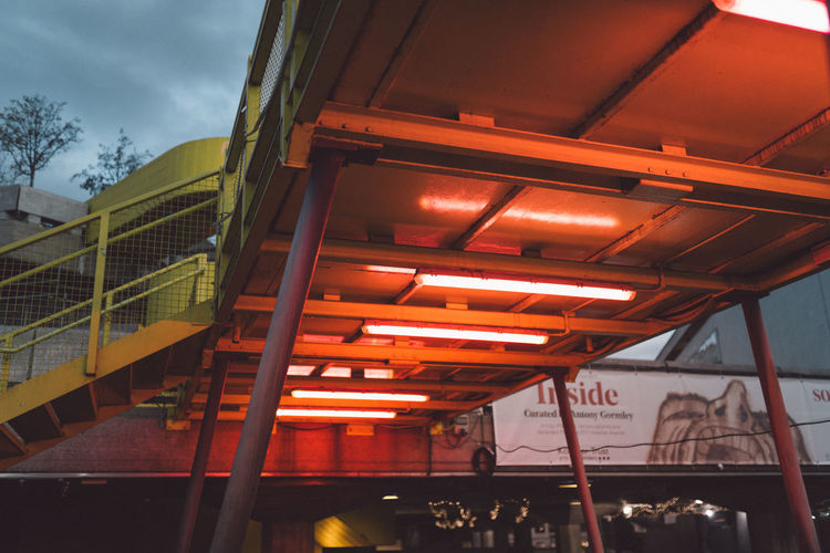 Architecture Industrial Architecture Built Structure Day Indoors  Low Angle View Metal Neon Neon Lights Real People Red Light Red Neon Sky