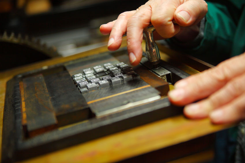 Tightening type block in chase One Person Indoors  Holding Skill  Close-up Leisure Activity Mature Adult Printer Man Hands Typography Letterpress Quoin Key Vintage Materials Securing Tightening Wood Material Textures Decorative Type Metal Type
