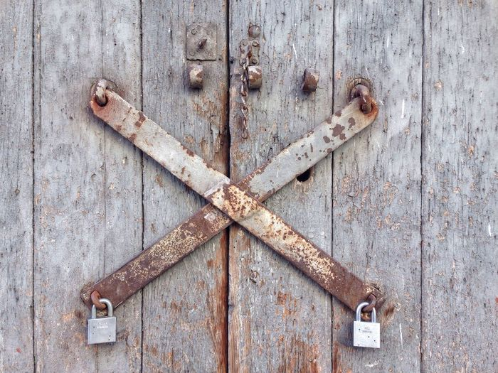 Padlocks On Closed Wooden Door