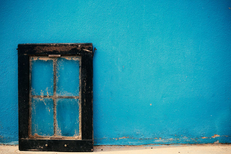 Close-up of blue window on wall