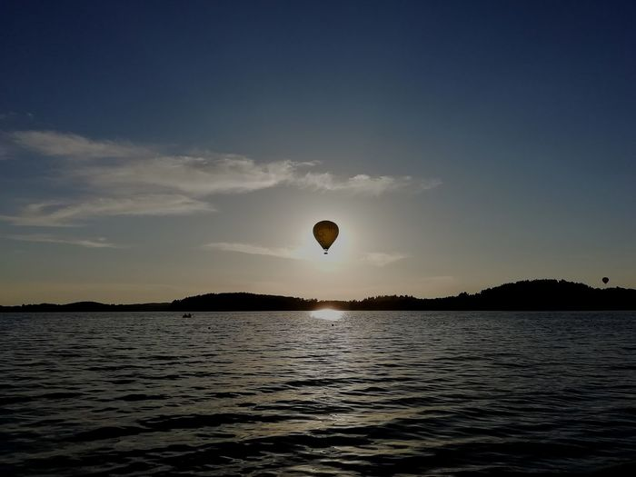 The Mobile Photographer - 2019 EyeEm Awards Water Hot Air Balloon Sea Flying Sunset Mid-air Sky Landscape The Great Outdoors - 2019 EyeEm Awards