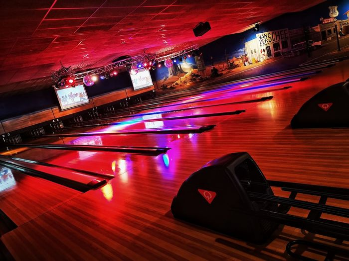 Bowling alley fun I Empty Empty Places Stillness Quiet Bowling Lane Red Red Color Bowling Bowling Alley Neon Lights Coloured Lights Colored Lights Game Sport Sports Mobilephotography Mobile Photography HUAWEI Photo Award: After Dark Water Illuminated Arts Culture And Entertainment High Angle View Neon Colored Fluorescent Light Fluorescent Disco Lights