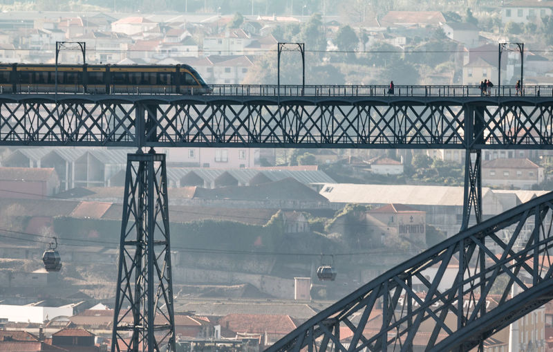 Train On Bridge Over Buildings In City