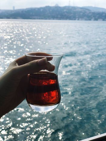 Hot tea View Human Hand Hand One Person Water Human Body Part Holding Sea Real People Drink Day Lifestyles EyeEmNewHere EyeEmNewHere
