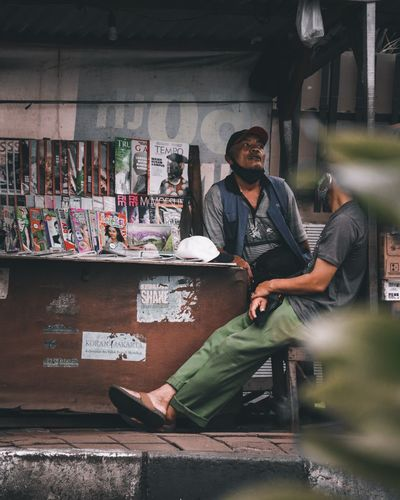 Portrait of young man standing at market