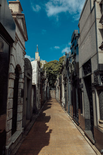 Buenos Aires Cemetery Cityscape Architecture Argentina Building Exterior Built Structure Cloud - Sky Day Graveyard Nature No People Outdoors Place Of Worship Recoleta Shadow Sky Spirituality Sunlight The Way Forward Tree