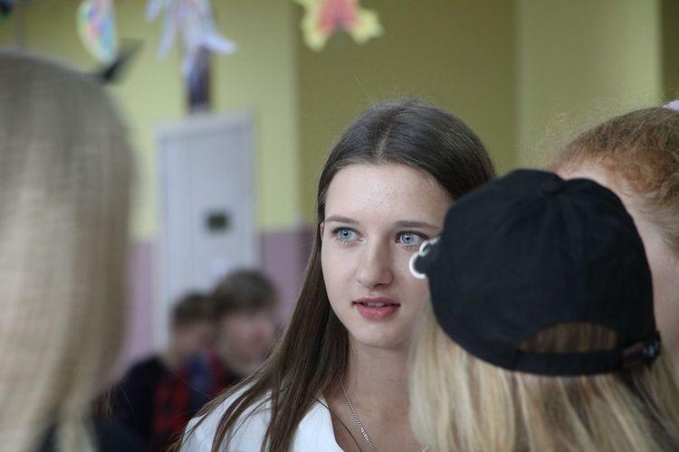 Teenage girl with friends in high school