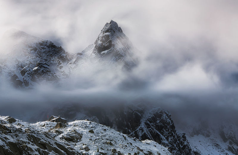 Capanna Albigna Albignahut Alps Beauty In Nature Bregaglia Cloud - Sky Cold Temperature Environment Fog Landscape Mountain Mountain Peak Mountain Range Nature No People Non-urban Scene Outdoors Scenics - Nature Sky Snow Snowcapped Mountain Switzerland Tranquil Scene Tranquility Winter