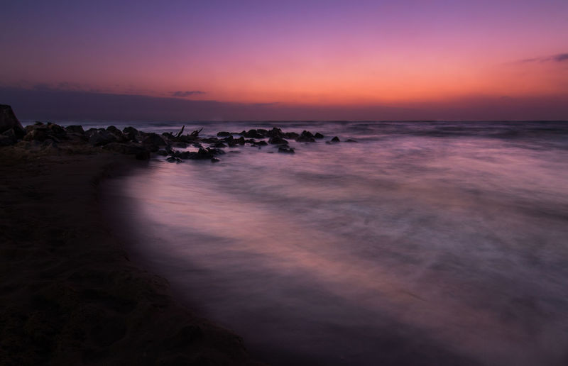 The birth of tomorrow Beach Blue Clouds Color Colorful Colors Light Long Exposure Magenta Mediterranean  Night Ocean Orange Red Rocks Sand Sea Sky Summer Sun Sunrise Travel Water Waves Yellow