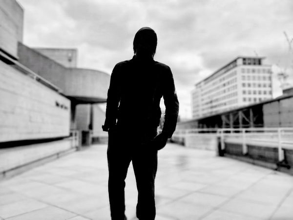 Silhouette of man Silhouette One Person Monochrome Black And White Man Walking Mysterious City Dof Shadow Silhouette Of A Man Walking Mood Atmospheric Sky Eerie Dark Who Is It? Weird Stranger Strangers EyeEm LOST IN London