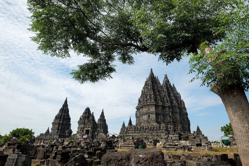 Prambanan Temple Religion Built Structure Belief Architecture Place Of Worship Tree Spirituality No People Outdoors Low Angle View Travel Tourism Travel Destinations Nature History Building Plant Building Exterior The Past Sky