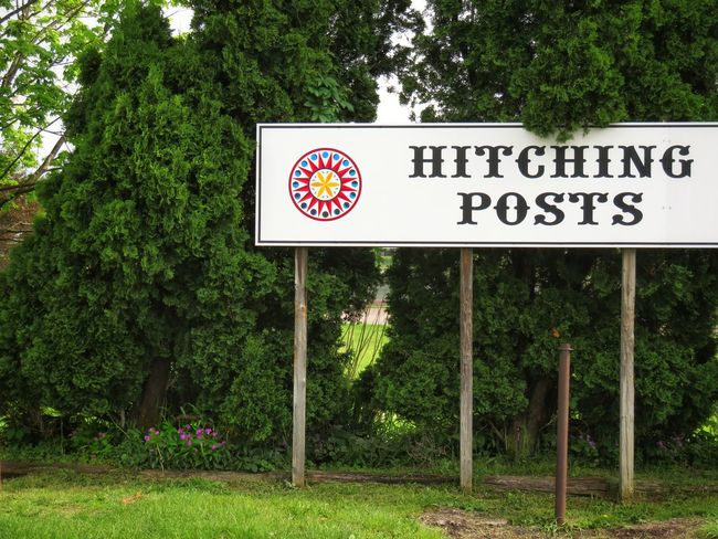 The EyeEm Collection Hitching Post Hex Sign Sign Western Script Tree Communication Text Road Sign Grass Information Capital Letter Information Sign Signboard Written Board
