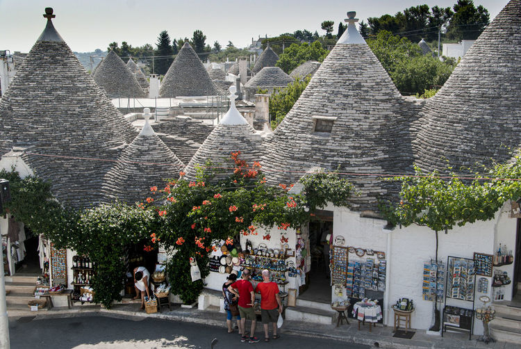 The magic of Alberobello's Trulli travel location - It was really amazing to know this particulars constructions full of charming and to ear the history about the Alberobello's Trulli in the Italy Apulia region (Puglia). The history said that the Alberobello's origins date back to the Middle Age. The settlers built the houses with stone and without cement and with the easiest way to demolish them in the case of an inspection by the Kingdom of Naples, thus avoiding paying taxes. Another interesting thing is the decorative pinnacles and symbols painted on many roofs of the trulli that were often used to identify the different religions of their inhabitants. Albelobelo Italia Viajes  2019 EyeEm Awards The Traveler - 2019 EyeEm Awards The Architect - 2019 EyeEm Awards The Photojournalist - 2019 EyeEm Awards The Street Photographer - 2019 EyeEm Awards Italy EyeEm Gallery EyeEm Best Shots Eyeem4photography Architecture Built Structure Building Exterior Building Group Of People Plant City Day Tree Real People Men Nature Adult Incidental People Travel Travel Destinations Large Group Of People Street Outdoors