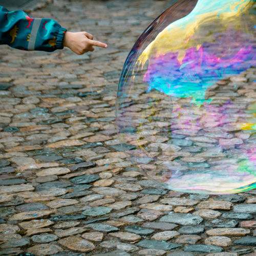Childhood Child Innocence Finger Hand Human Body Part One Person Human Hand Holding Real People Day Body Part Multi Colored Nature Leisure Activity Lifestyles Outdoors Soap Bubbles Big Bubbles Bubble Popular Photos Pop Bubbles Cityscape Water High Angle View Human Limb Low Section Human Foot