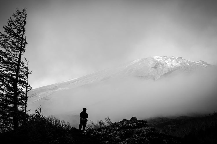 Silhouette Person Standing Against Mount Fuji During Foggy Weather