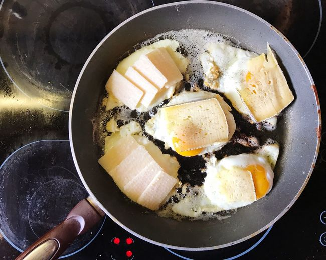 Directly Above Shot Of Fried Egg And Cheese In Cooking Pan