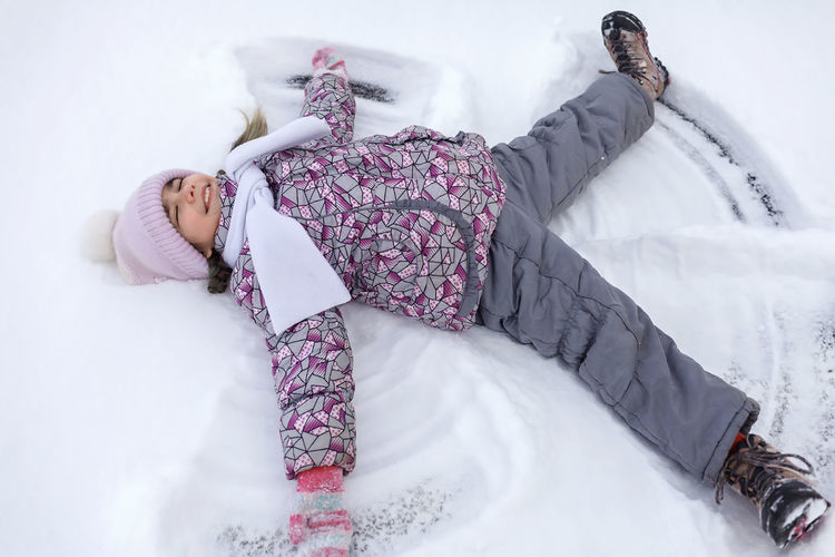 High angel view of girl on snow covered land
