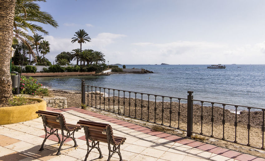 Ibiza island Ibiza Ibiza, Spain Mediterranean Coast SPAIN Beach Beauty In Nature Chair Coast Horizon Horizon Over Water Nature No People Outdoors Palm Tree Plant Railing Scenics - Nature Sea Seat Sky Table Tranquility Tree Tropical Climate Water