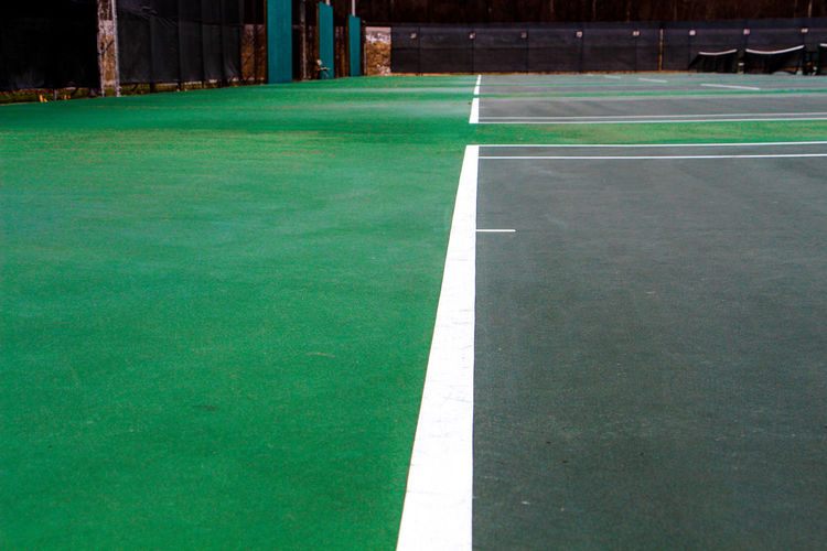 Dividing Line Empty Empty Road Green Green Color Long Narrow No People Outdoors Playing Field Road Solitude Surface Level Tennis Tennis Court Tennis 🎾 Tenniscourt The Color Of Sport The Way Forward Tranquil Scene Tranquility
