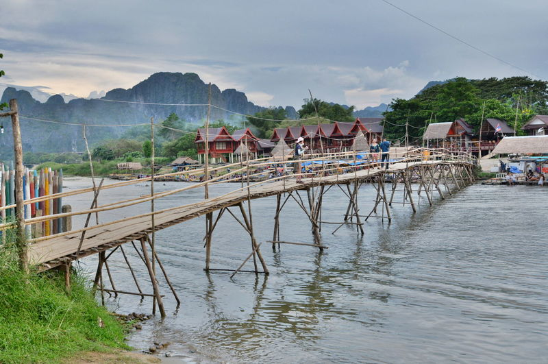Bamboo bridge on Nam Song river. Vang Vieng. Laos Architecture Asian  Bamboo Bamboo Bridge Bamboo Bridge On The River Bridge Landscape Laos Laos Travel Limestone Mountains Nam Song River Outdoors Scenics Tourism Destination Tranquil Scene Tranquility Travel Destinations Vang Vieng Vang Vieng, Laos Vientiane Province Walking Bridge Wooden Bridge