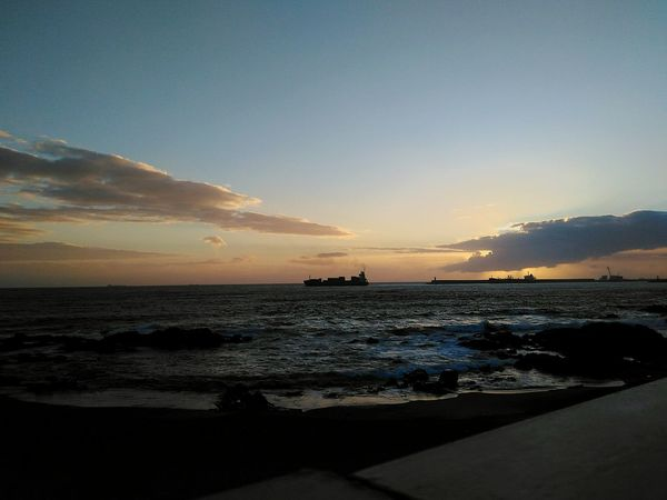 Sunset Sea Beach Silhouette Sky Horizon Over Water Tranquil Scene No People Travel Destinations Sun City Colour Of Life Simplicity Personal Perspective Oporto Darkness And Light Eyemphotography Beauty In Nature Get Inspired Boat Sunset Silhouettes