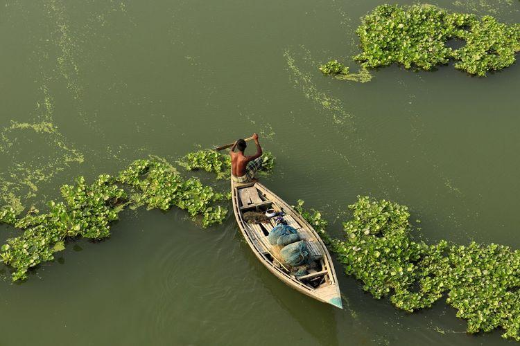 High angle view of man floating on lake