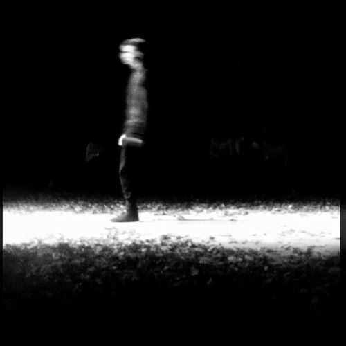 Full length of woman in dark room