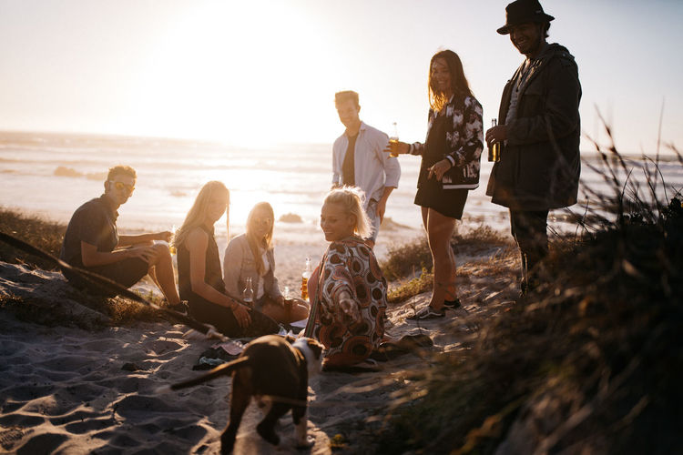 Group Of People Land Beach Sea Leisure Activity Sky Nature Togetherness Water Sunset Child Men Casual Clothing Young Adult People Group Holiday Trip Women Males  Outdoors Teenager
