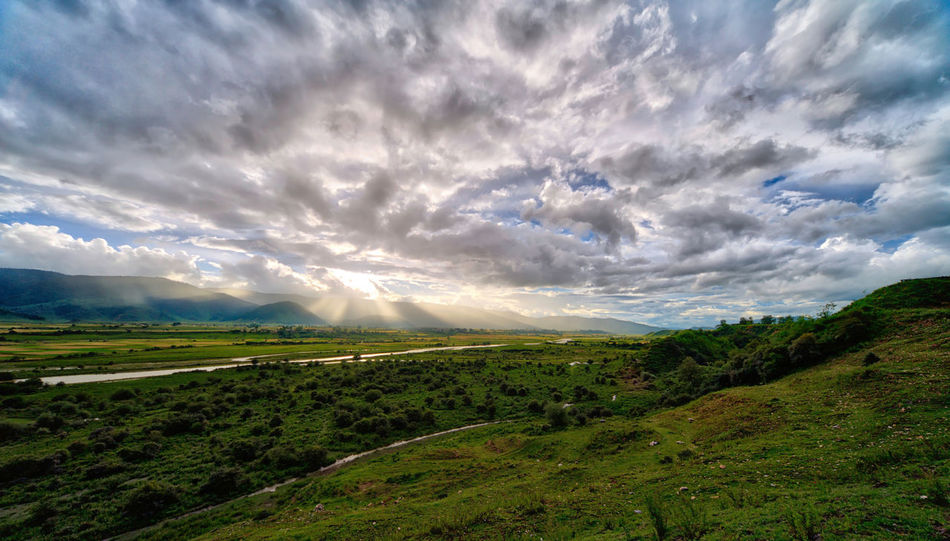 A spectacular sunset in the Shangri-La region of Northern Yunnan, China. Majestic Nature Majestic Sunsets Shangri-La Sunrays Travel Photography Beauty In Nature China Cloud - Sky Field Green Color Landscape Majestic Sky Nature No People River Scenics Sunset Tranquil Scene Travel Destinations Travelphotography Yunnan