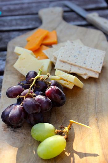cheese, grapes and cracker snack Bunch Close-up Cutting Board Day Food Food And Drink Freshness Fruit Grape Healthy Eating High Angle View Indoors  No People Table Wood - Material