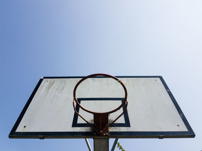 Clear Sky Basketball Hoop Low Angle View Empty Abandoned Basketball - Sport Close-up Net - Sports Equipment Obsolete Basketball Geometric Shape High Section Damaged Blue Copy Space