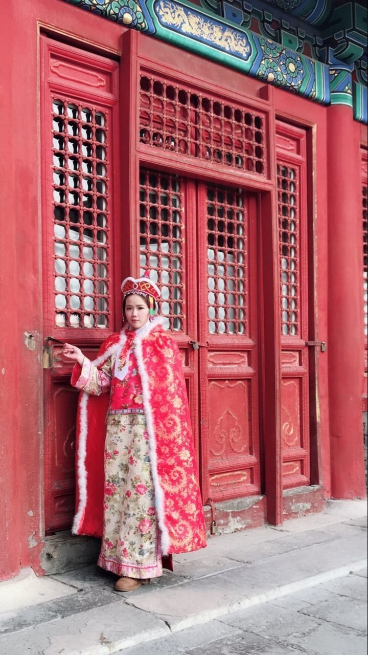 red, architecture, full length, traditional clothing, built structure, building exterior, clothing, building, standing, people, smiling, entrance, day, door, real people, women, adult, celebration, festival, wedding ceremony