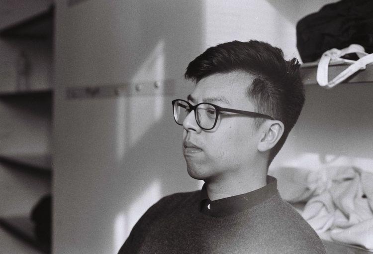 Close-up of boy wearing eyeglasses