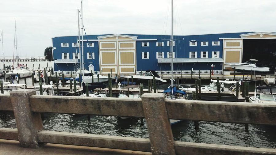 Marina life. Houseboats and condos. Marina Living Houseboats Sailboats Colorful Condos