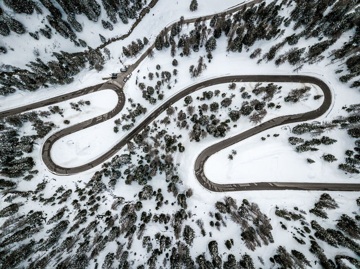 Snow Aerial View Cold Temperature No People High Angle View Winter Transportation Plant Road Tree Scenics - Nature Nature Environment Land Day Mode Of Transportation Beauty In Nature Car Motor Vehicle Outdoors Snowcapped Mountain