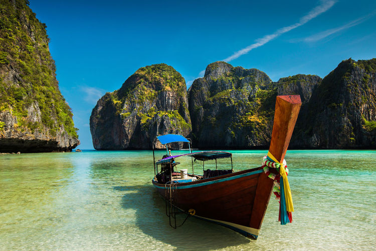 Beauty In Nature Day Land Longtail Boat Mode Of Transportation Moored Mountain Nature Nautical Vessel No People Outdoors Rock Rock - Object Rock Formation Scenics - Nature Sea Sky Tranquil Scene Tranquility Transportation Turquoise Colored Water