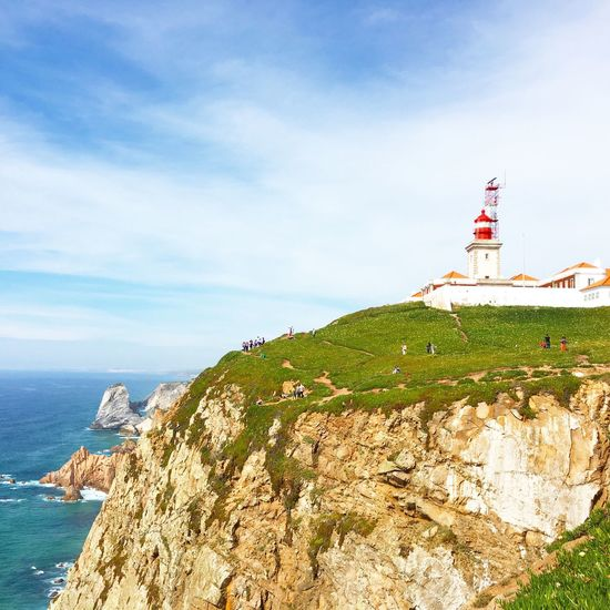 Lighthouse Sea Water Nature Sky Cliff Beauty In Nature Tranquility Cloud - Sky Scenics